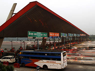 Vehicles pass through a toll plaza in Gurgaon on the outskirts of New Delhi
