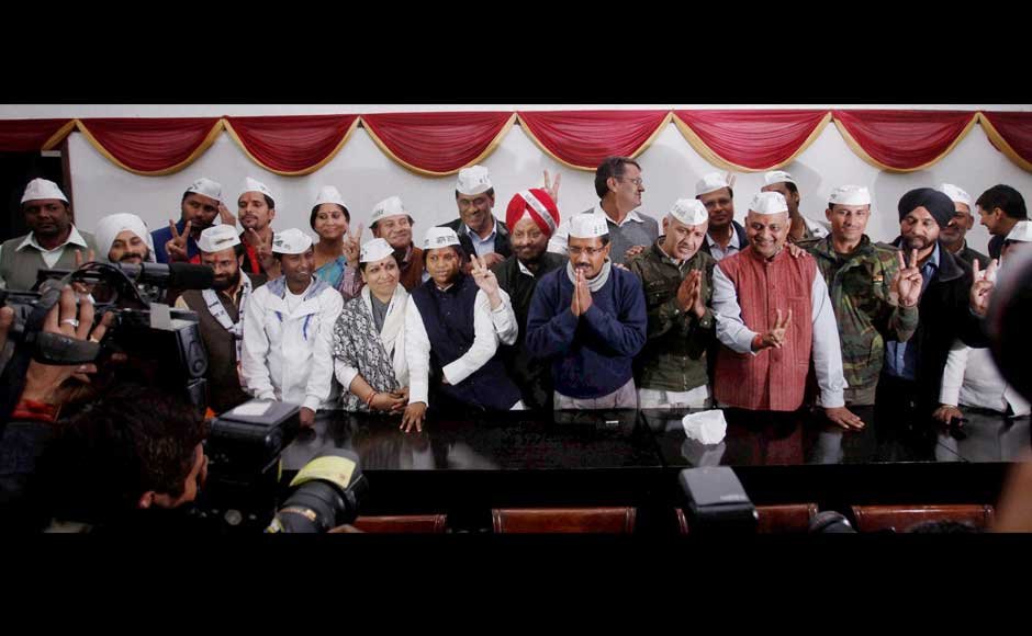 Aam Aadmi Party convener Arvind Kejriwal with Manish Sisodia and the party's 26 elected candidates during a meeting in New Delhi on Monday.PTI