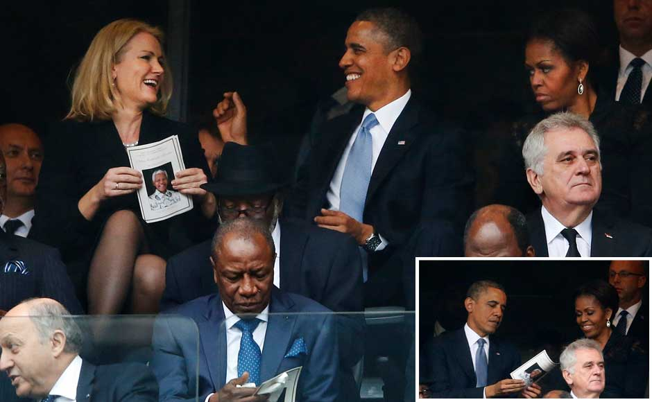 President Barack Obama jokes with Danish prime minister, Helle Thorning-Schmidt, left, as first lady Michelle Obama looks on at right during the memorial service for former South African president Nelson Mandela at the FNB Stadium in Soweto, near Johannesburg, South Africa, Tuesday Dec. 10, 2013. AP/ Reuters