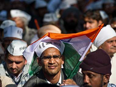 An AAP volunteer during a political rally. AFP