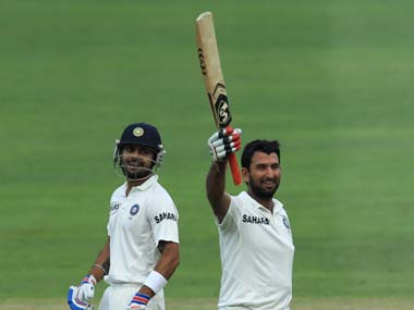 Cheteshwar Pujara celebrates reaching his 6th Test century. AP