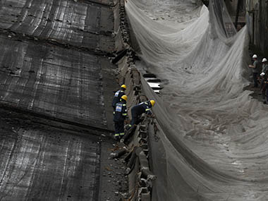 Construction workers remove debris after the demolition of Perimetral overpass, as part of Rio's Porto Maravilha urbanization project, in Rio de Janeiro November 24, 2013. The project, which is supported by the state and federal government of Rio de Janeiro, is for the city's redevelopment ahead of the 2016 Olympic Games. Reuters