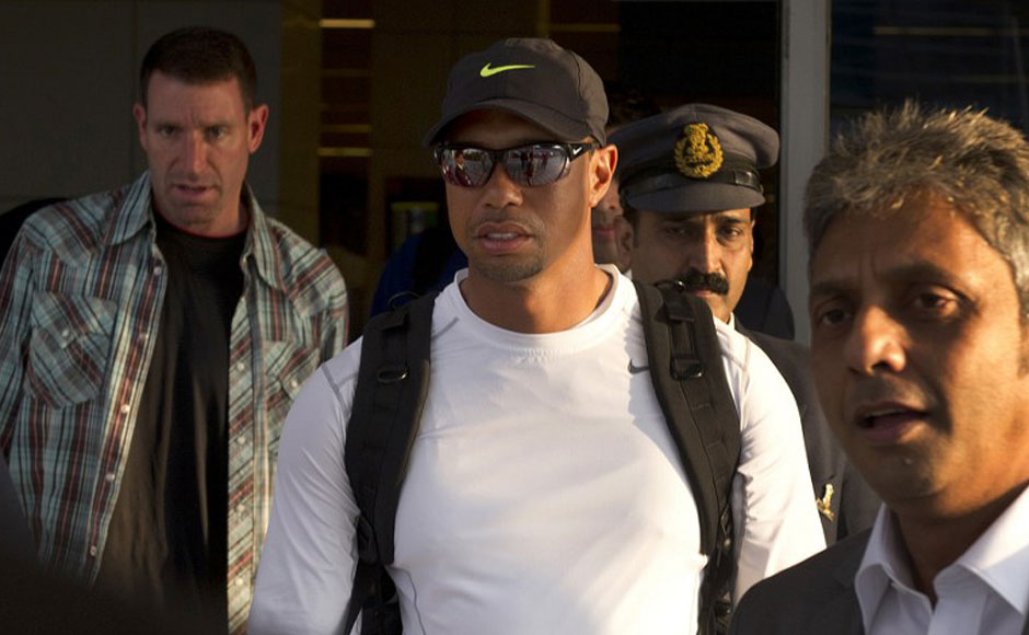 US golfer Tiger Woods (C) arrives at the International airport in New Delhi. Tiger Woods is making his first visit to India and will compete, in an 18-hole corporate outing at the Delhi Golf Club. AFP