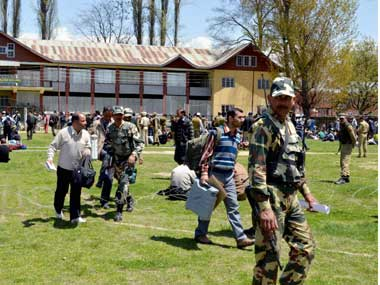 Polling parties leave for election duty on the eve of Lok Sabha elections in Anantnag. PTI