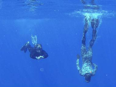 In this April 7, 2014 photo provided by the Australian Defense Force Able Seaman Clearance Divers Matthew Johnston, right, and Michael Arnold, from the Australian Defense Vessel Ocean Shield, scan the water for debris from the missing Malaysia Airlines Flight 370 in the southern Indian Ocean. AP