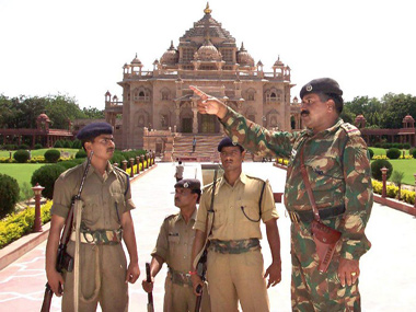 File photo of security personnel inspecting Akshardham temple premises after the attack in 2002. AFP