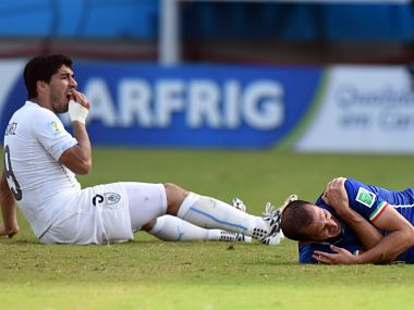 Luis Suarez (L) and Italy's defender Giorgio Chiellini react after clashing. AFP