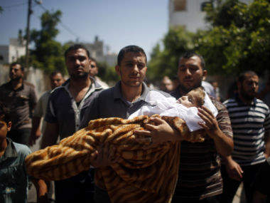 Relative carry a four-year-old Palestinian girl who was killed in an Israeli air strike in the northern Gaza Strip. Reuters image