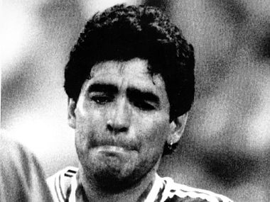 The July 8, 1990 file photo shows Agentina's Diego Maradona fighting back his tears. AP
