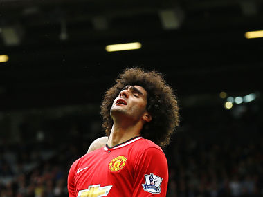 Manchester United's Marouane Fellaini reacts during their English Premier League soccer match against Swansea City at Old Trafford. Reuters