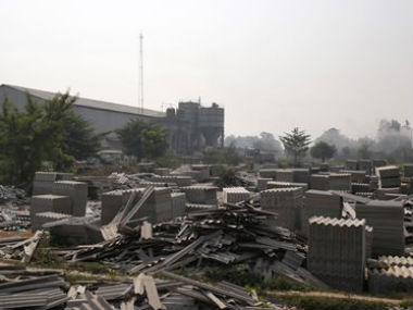 In this November 23, 2013 photo, asbestos cement roof panels, some broken and rejected, lie on the grounds of Nibhi Industries Pvt. Ltd. in the district of Bhojpur in the north Indian state of Bihar. AP
