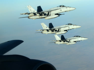 A formation of U.S. Navy F-18E Super Hornets leaves after receiving fuel from a KC-135 Stratotanker in this file photo. AP