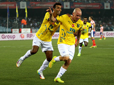 Iain Hume of Kerala Blasters FC celebrates his goal against Atletico with Milagres Gonsalves. Sportzpics