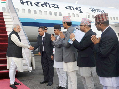 Prime Minister Narendra Modi being welcomed in Nepal. PTI