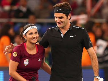 Roger Federer and Sania Mirza of the Indian Aces. Getty Images