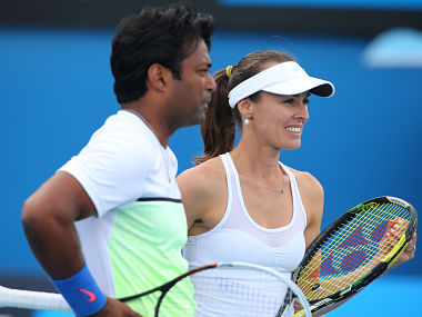 Martina Hingis and Leander Paes in action in their first round mixed doubles match against Masa Jovanovic and Sam Thompson. Getty