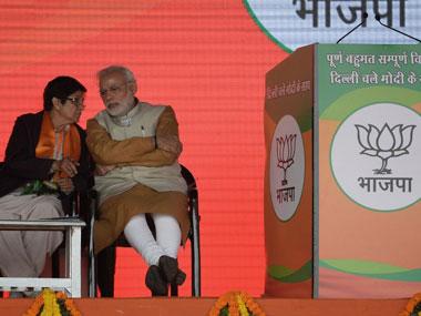 Kiran Bedi with Narendra Modi. AFP.