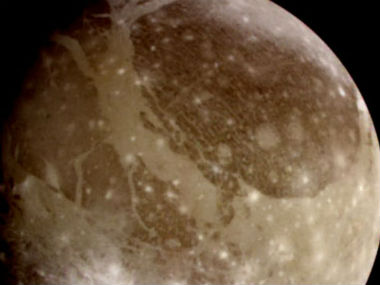 This June 2000 image provided by NASA taken by NASA's Galileo spacecraft shows Ganymede, Jupiter's largest moon. AP