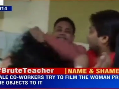 Screenshot from footage showing the man assaulting the female professor. Courtesy: Youtube