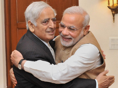 File image of Mufti Mohammad Sayeed and PM Narendra Modi. PTI