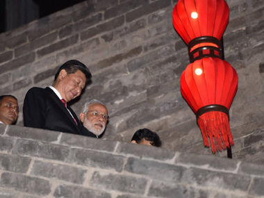 PM Narendra Modi and Chinese President Xi Jinping in Xian on Thursday. PTI