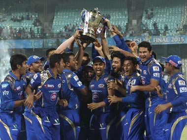 The Mumbai Indians team poses with the IPL trophy. Sportzpics