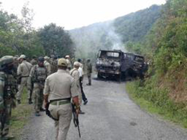 Security personnel comb the site of attack in Manipur's Chander district . AFP
