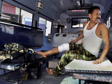 An injured CRPF jawan being brought to Gauhati Medical College Hospital (GMCH) for treatment after clashes between CRPF and protestors in Guwahati on Friday. PTI
