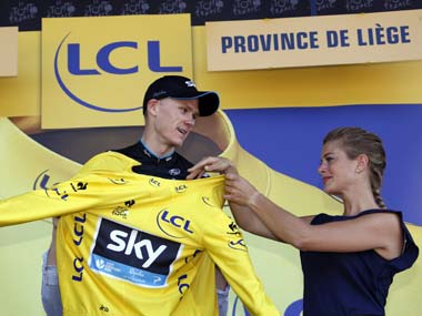 Chris Froome gets into the yellow jersey. Reuters