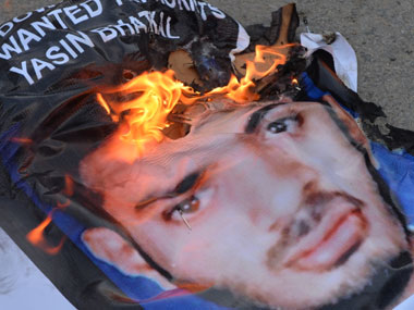 A poster of Yasin Bhatkal being burnt. AFP.