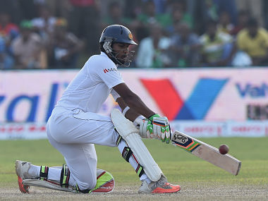 Dinesh Chandimal plays a reverse sweep during the third day of 1st Test. AFP