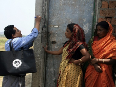 A representational image of a census official marking a house after collecting details from a village resident. Reuters