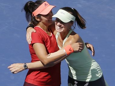 Sania Mirza and Martina Hingis. AP