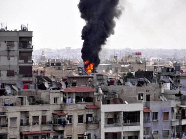 Mortar shells slammed into several areas of the Syrian capital. AFP