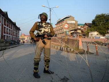 An Indian paramilitary soldier stands guard in an empty street as restrictions are put into place ahead of a planned Muharram procession in Srinagar on Thursday. AFP