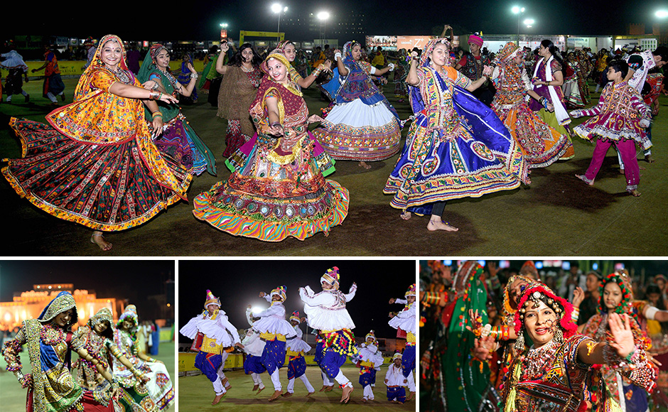 People dressed in traditional attire play Garba (a dance form) as they celebrate Navratri in Gandhinagar, India 13 October, 2015. Navratri is a 10 day festival in which nine different forms of goddess Durga are worshipped on nine consecutive nights and the tenth day is referred as Dassera. SOLARIS IMAGES