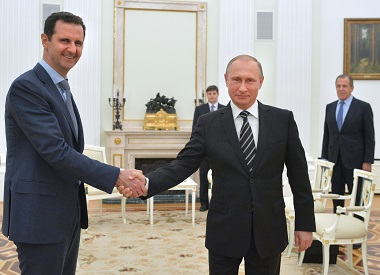 Russian President Vladimir Putin (R) shakes hands with his Syrian counterpart Bashar al-Assad (L) in a file photo. AFP