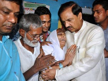 Union Minister Mahesh Sharma meets the Dadri victim's family. PTI
