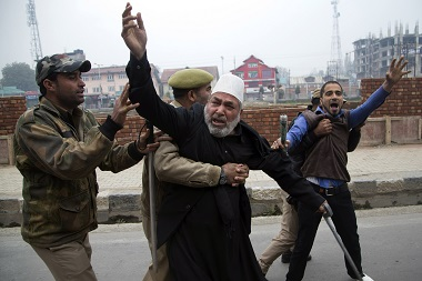 A Kashmiri Shiite Muslim shouts slogans as policemen detain him for participating in a religious procession during restrictions in Srinagar on Saturday, Oct. 24, 2015. AP