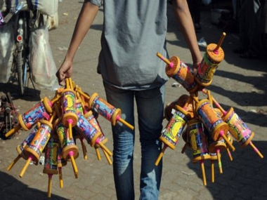 A youth holds special kite-reels wound with 'manjha — kite-flying thread prepared by coating a cotton thread with a mix of glue and ground glass. AFP
