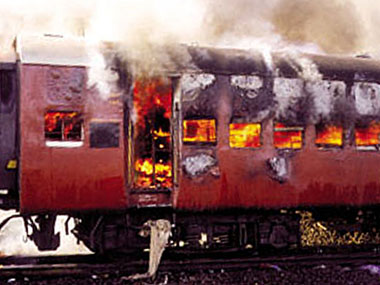 Smoke pours from the carriage of a train on fire in Godhra on 27 February, 2002. Reuters