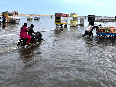 A motorbike wades through water in Chennai after death toll in Tamil Nadu due to heavy rains rises to 71. PTI