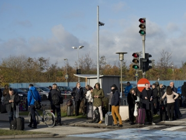 People wait outside Kastrup airport in Copenhagen on November 18, 2015. AFP