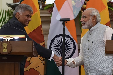 Sri Lankan Prime Minister Ranil Wickremesinghe (L) and Narendra Modi shake hands at a joint press conference on 15 September. AFP