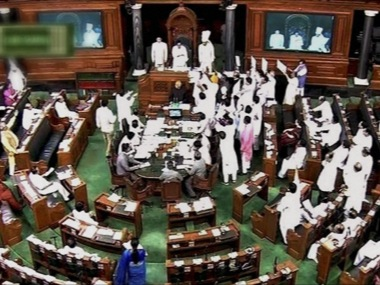 Opposition protesting during the monsoon Session of Parliament. PTI