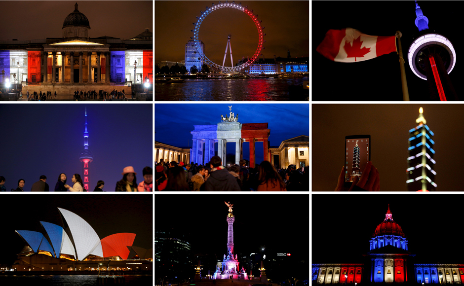 The world reels in shock monuments light up in colours of for Lit national