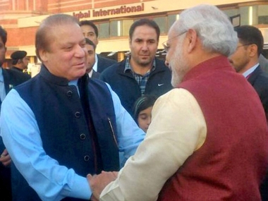 PM Narendra Modi greeted by Pakistani counterpart Nawaz Sharif on his arrival in Lahore. PTI