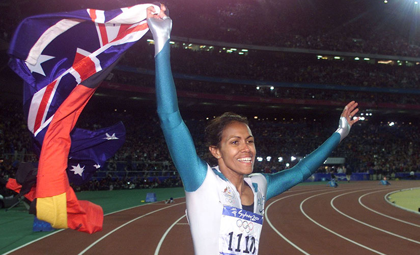 Cathy Freeman's iconic image with the Australian and Aboriginal flags. Reuters