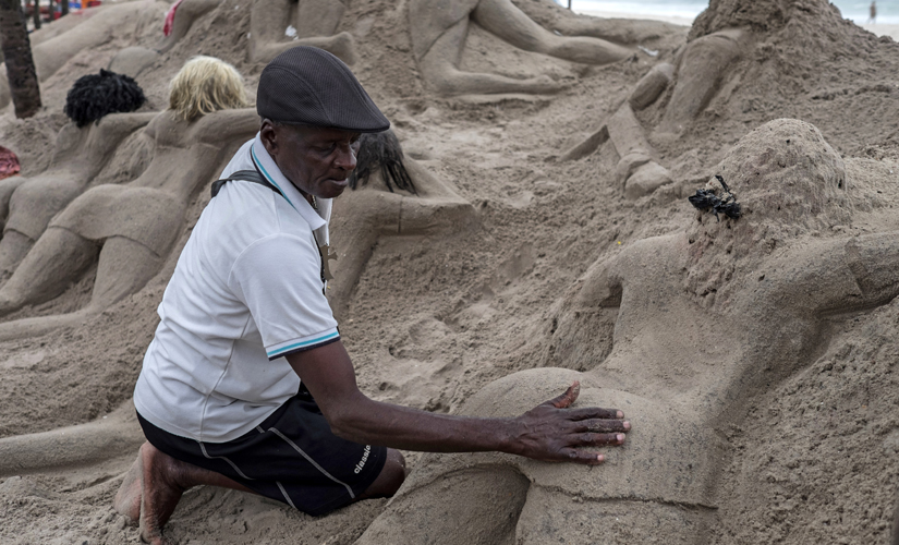 Feeling hot hot hot: Risqué sand sculptures of women on ...