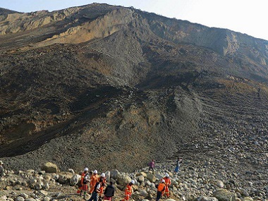 Rescue workers are pictured at the site of the landslide in Hpakant, Kachin State. AFP